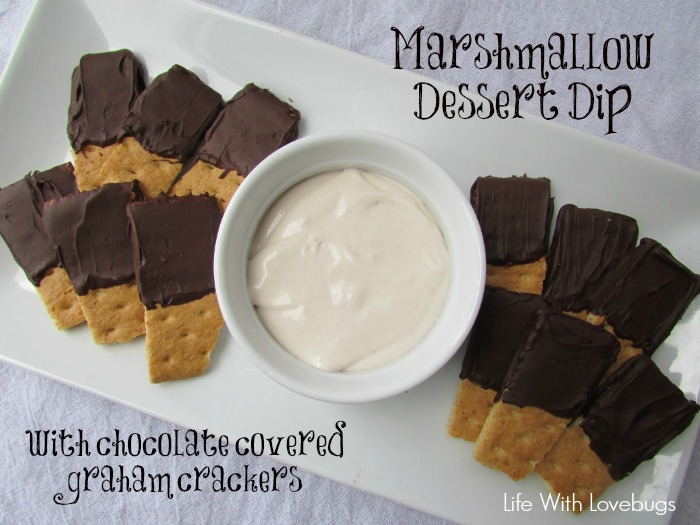 Marshmallow dessert dip with chocolate covered graham crackers